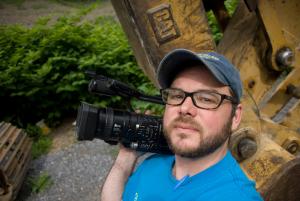 Documentary film-maker Tom Hansell (http://2.bp.blogspot.com/-A9HeHiVO6sM/TZ8NCy4X4UI/AAAAAAAAACA/ClLMuetYMLA/s1600/Tom+Hansell+-+portrait+2.jpg).
